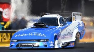 Tommy Johnson Jr. drives Make-a-Wish Funny Car back to winner's circle at Route 66 NHRA Nationals